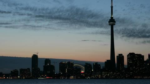 The Toronto skyline brightens as the colorful sky darkens Stock Video Footage