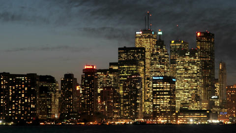 The Toronto skyline sparkles with light under the... Stock Video Footage