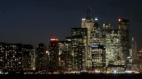 The Toronto skyline sparkles with light under the darkening sky Footage