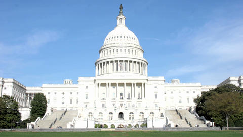 Visitors And Legislators Walk Into And Out Of The United States Capitol Building stock footage
