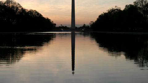 The Washington Monument is silhouetted against a colorful... Stock Video Footage