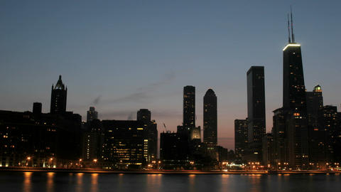 Lights brighten as the sky darkens in downtown Chicago Stock Video Footage