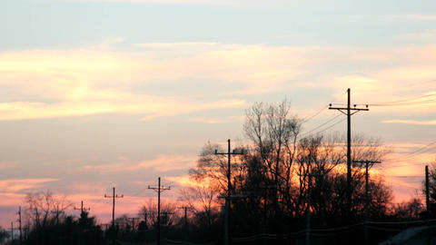 An orange and pink sky brightens then fades behind the... Stock Video Footage