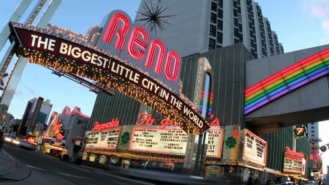 Time-lapse shot of traffic passing under a welcome sign for Reno, Nevada, the Biggest Little City in Footage
