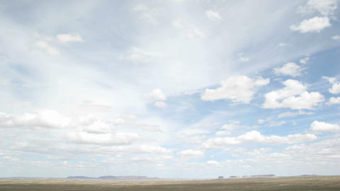 Time lapse shot of white clouds moving over the desert in Shiprock, New Mexico Footage