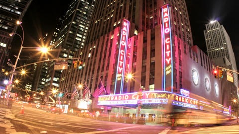 Pink and gold lights merge in an accelerated shot of traffic passing in front of Radio City Music Ha Footage