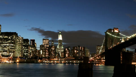 Slow pan of a time-lapsed view of the Brooklyn Bridge and... Stock Video Footage
