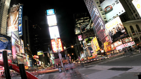 Fish-eye, tilted view of accelerated traffic and pedestrians in New York's Times Square Footage