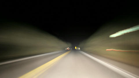 A time-lapsed, point-of-view shot of driving on an Oregon highway at night Footage