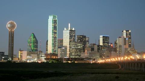 City lights illuminate the Dallas skyline at night Stock Video Footage