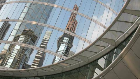 Skyscrapers reflect in the mirrored walls of the Houston... Stock Video Footage