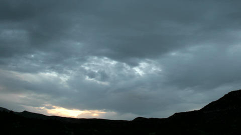 Slow pan as golden light flares at the horizon beneath... Stock Video Footage