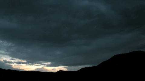 Slow pan as golden light flares at the horizon beneath... Stock Video Footage