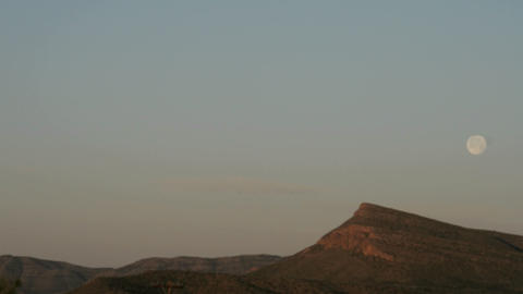 Time lapse shot of the moon setting over the Texas hills Footage
