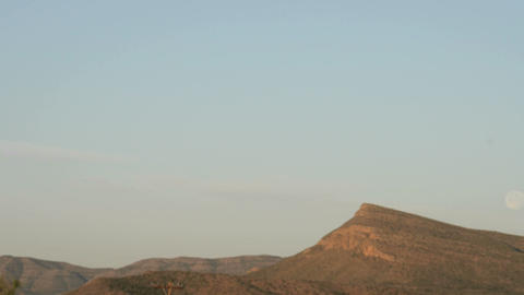Time lapse shot of the moon setting over the Texas hills Stock Video Footage