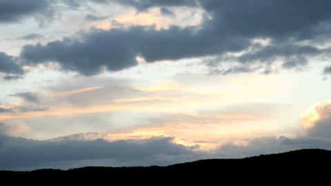 A gold and orange sky intensifies in color as it is... Stock Video Footage