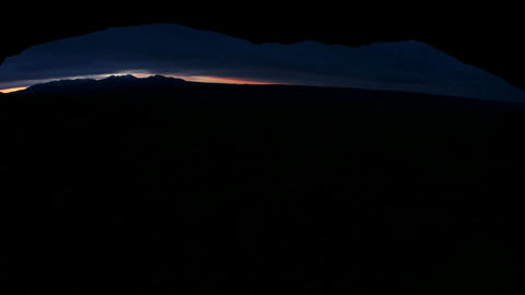 Bright light pierces the dark horizon during golden-hour... Stock Video Footage