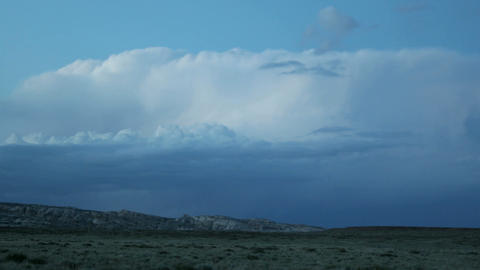 Lighting flashes from storm clouds over Goblin Valley... Stock Video Footage