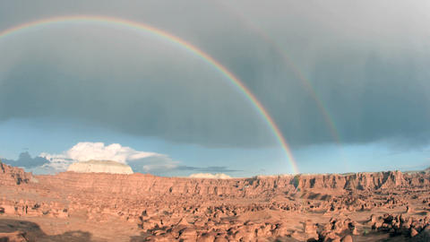 A rainbow arches over Goblin Valley State Park Stock Video Footage