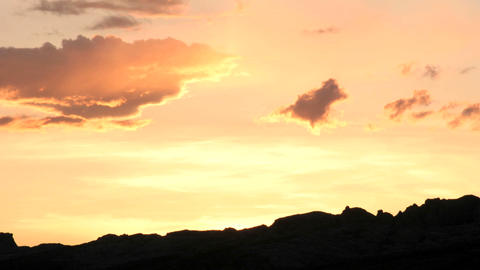 Slow right-pan of bright orange colors in the golden-hour... Stock Video Footage