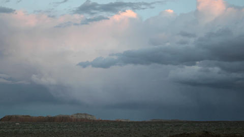 Storm clouds in the golden-hour take on muted shade of... Stock Video Footage
