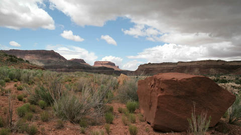 Storm clouds move over the desert of Mexican Hat Canyon Footage