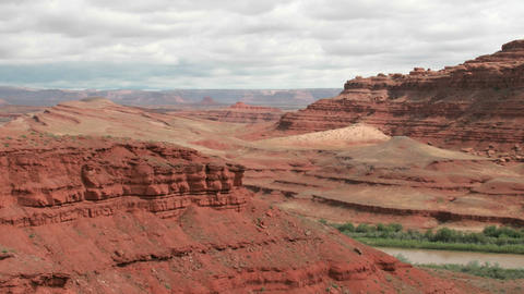 Slow right-pan of a time-lapse shot of Utah's Mexican Hat Canyon Footage