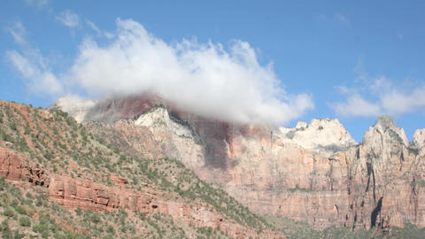 Time-lapse shot of cloud formations over a mountain peak... Stock Video Footage
