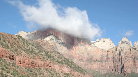 Time-lapse shot of cloud formations over a mountain peak in Zion National Park Footage