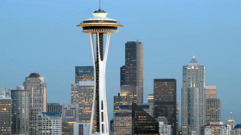 Slow left-pan of the Seattle Space Needle and the surrounding buildings in Seattle's skyline Footage