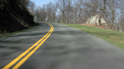 An accelerated point-of-view shot of driving on a highway in the Blue Ridge Mountains Footage