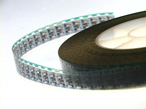 Selective-focus of an unrolled spool of film Footage