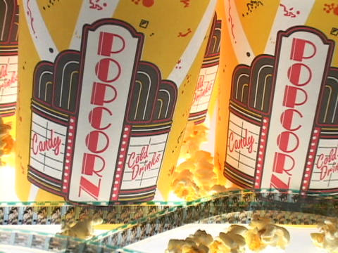 Film and popcorn holders are laid out in a display Stock Video Footage