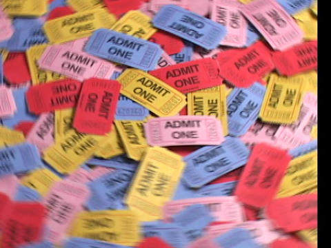 A bird's-eye view of colorful batch of rotating tickets Stock Video Footage