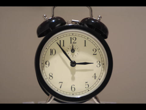 Close-up of an alarm clock's hands, quickly moving around... Stock Video Footage