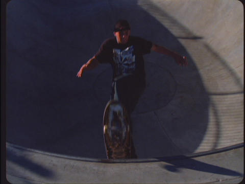 A slow-motion shot of a boy doing an exciting jump on his skateboard Footage