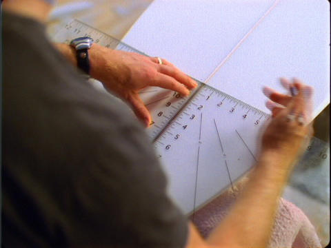A close-up shot of a man building a surfboard Footage