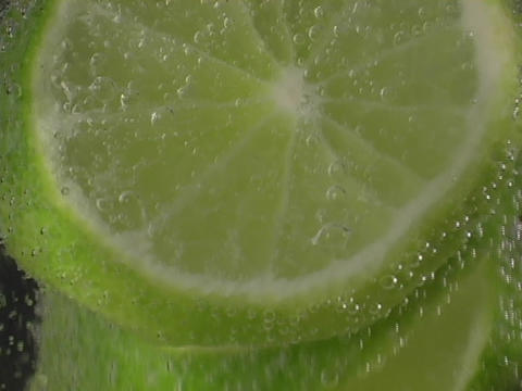 Lime slices rise in soda Footage