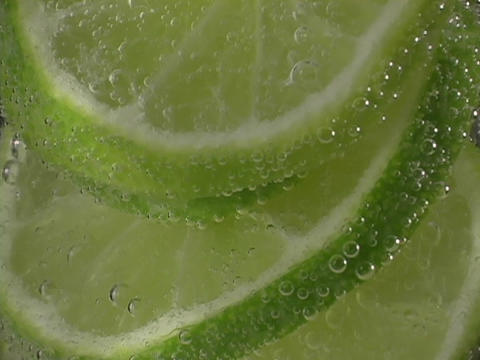 Lime slices rise in soda Stock Video Footage