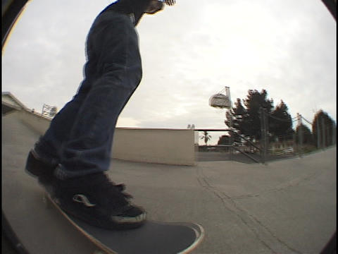 A skate-boarder tries out different tricks on the pavement Stock Video Footage