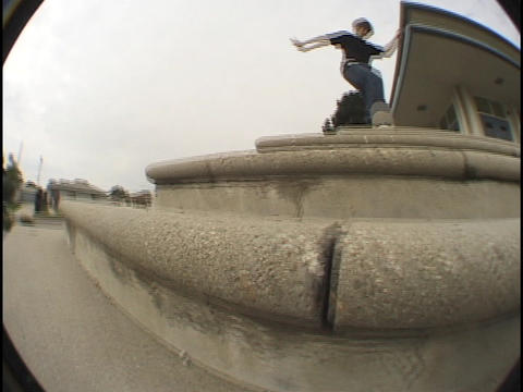 A skateboarder jumps over steps Stock Video Footage