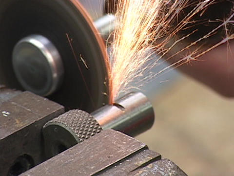 A saw cuts a large metal bolt Stock Video Footage