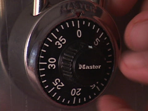 A person turns a combination lock Stock Video Footage