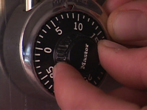 A person turns a combination lock Footage