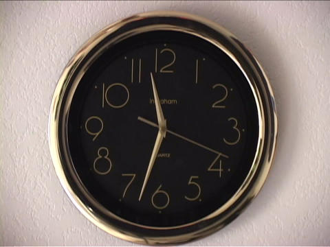 Hands spin quickly on a clock Stock Video Footage