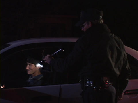 A police officer questions a man in a car that he has... Stock Video Footage