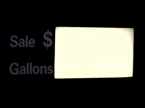 A gas pump records dollars and gallons Stock Video Footage