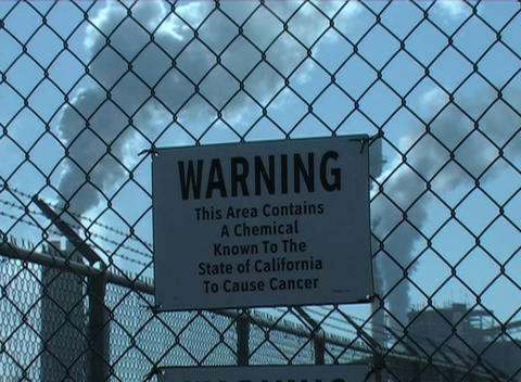Warning signs indicate that cancer causing agents are being put into the air Footage