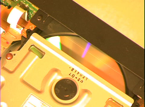 A compact disk slides through a slot Stock Video Footage