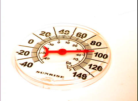 The needle on a thermometer points to around 92 degrees Stock Video Footage